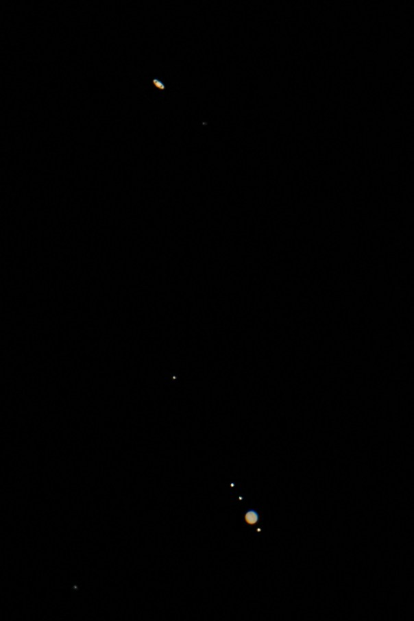 Io, Jupiter, Europa, Ganymede, Callisto, Titan, and Saturn (bottom to top)
