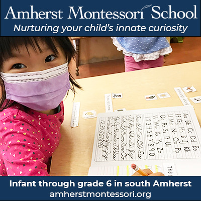 "Photograph of young student practicing writing with text overlay: ""Amherst Montessori School. Nurturing your child's innate curiosity. Infant through grade 6 in south Amherst. amherstmontessori.org."""