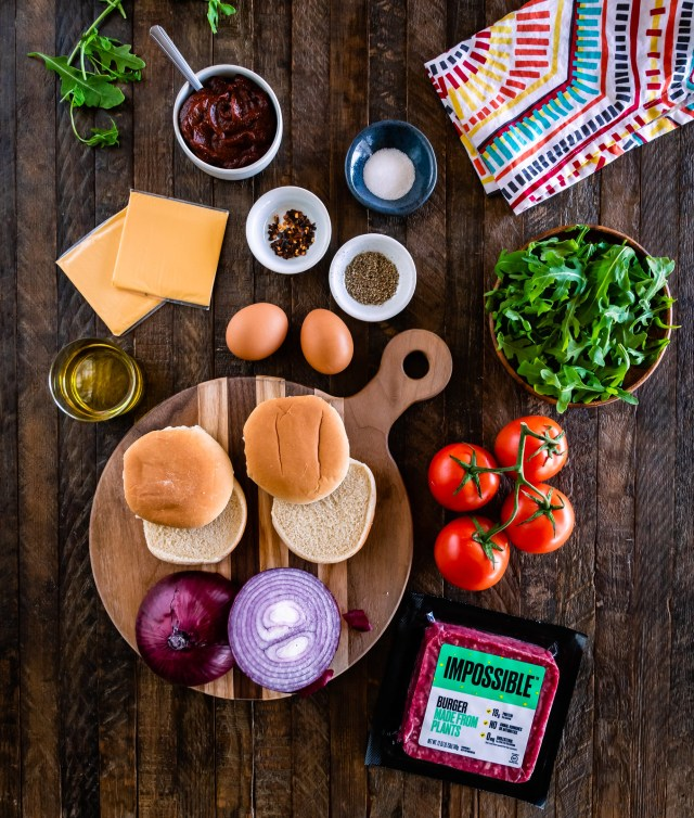a spread of colorful ingredients to make impossible breakfast sliders