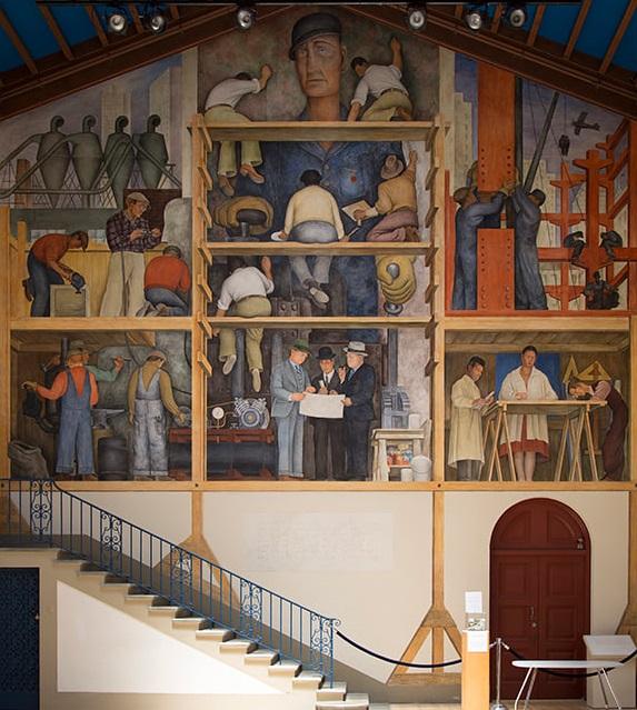 La realización de un fresco que muestra la construcción de una ciudad