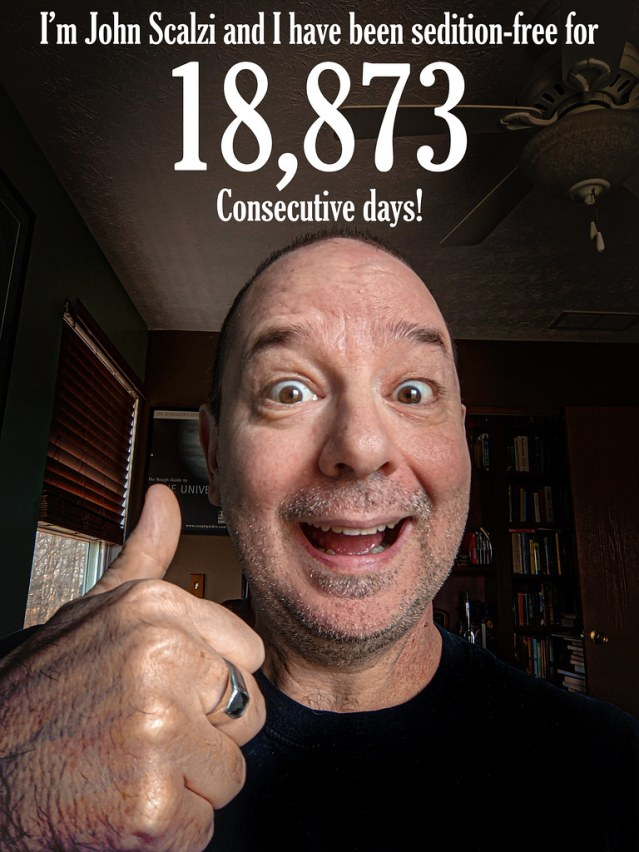 """A picture of me giving a thumbs up and the words """"I'm John Scalzi and I have been sedition-free for 18,873 consecutive days!"""""""