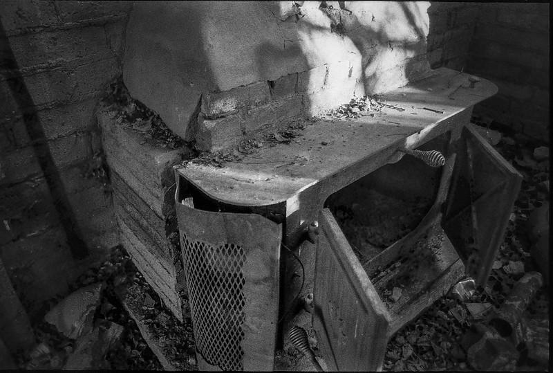 old stove and chimney, abandoned mill, urban decay, River District, Asheville, NC, Minolta XG-M, Super Albinon 28mm f-2.8, Fomapan 400, HC-110 developer, 1.16.21