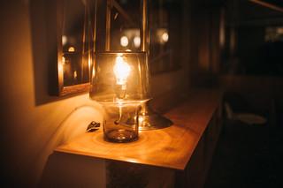 transparent glass lamp illuminating a dark room ivan radic flickr