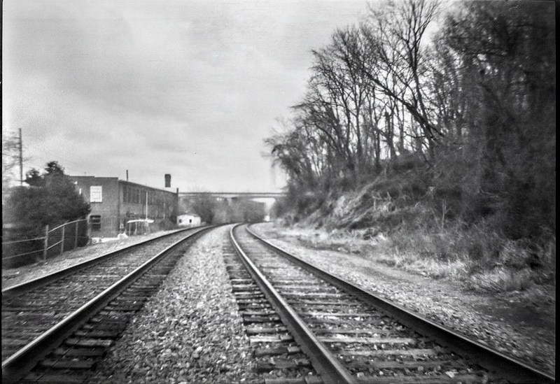 converging railroad tracks, distant overpass, River District, Asheville, NC, Afga Chief, Bergger Pancro 400, Ilford Ilfosol 3 developer, 2.4.21