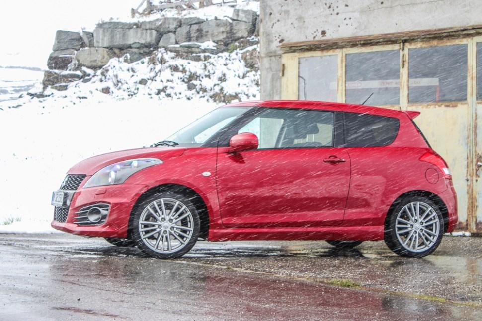 red Suzuki Swift Sport during snow in southern Switzerland