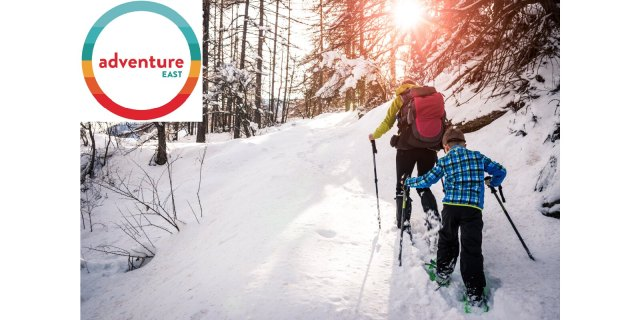 "Photograph of parent and child snowshoeing with ""Adventure East"" logo overlay."