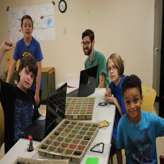 Photo of children playing Minecraft.