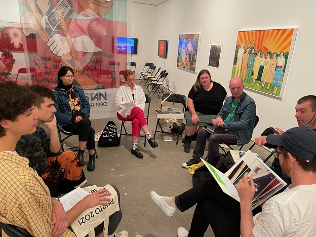 A small group discuss Photobooks at the CCP Fistzroy