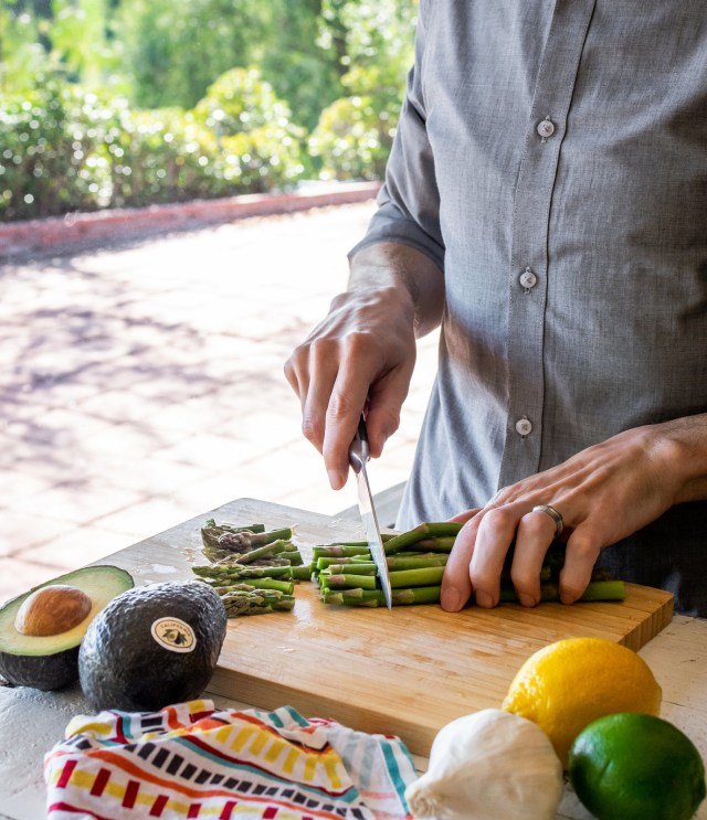 slicing asparagus spears into 1-inch pieces