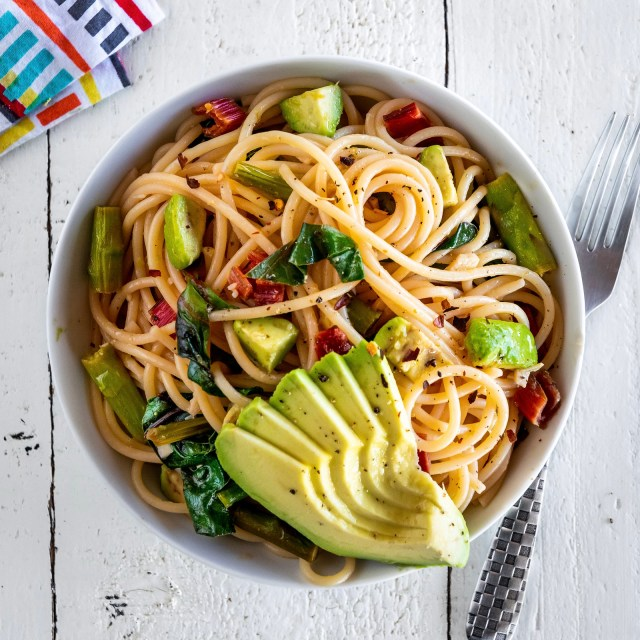 spaghetti with asparagus, wilted greens, and avocado