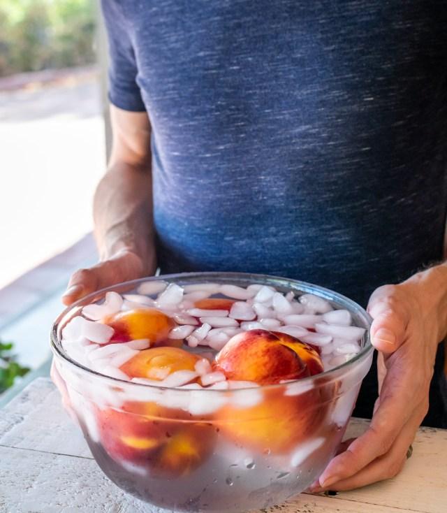 an ice bath makes peeling the peaches easy