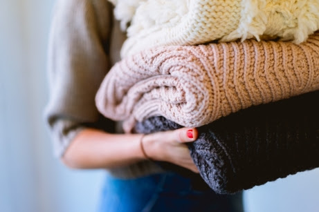 Holding Sweaters