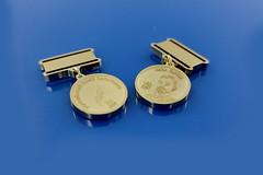 miniatury medali wykonane w mosiądzu