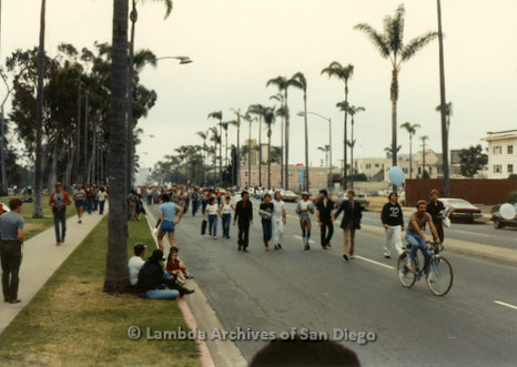 1982 - San Diego Lambda Pride Parade, marchers on parade route walking up 6th. Avenue from west end of Balboa Park toward Hillcrest.