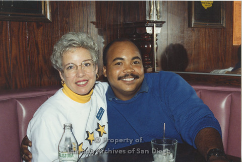 P001.247m.r.t Through The Years Fundraiser: Beth Cooper and a man in a booth