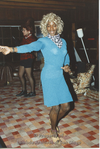 P001.227m.r.t Retreat 1991: man dressed in drag wearing a blue dress