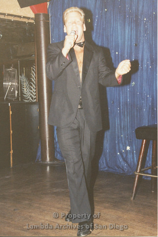 P001.254m.r.t Through The Years Fundraiser: man in tuxedo holding a microphone