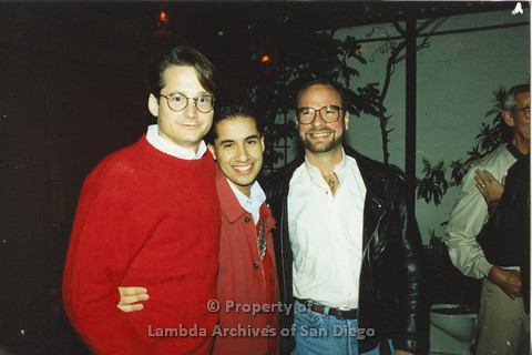 P001.292m.r.t X-mas: 3 men, one in a red sweater and one in a black leather jacket