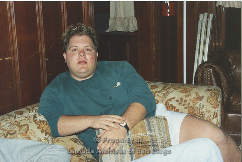 P001.196m.r.t Retreat 1991: man in green sweater sitting on a couch