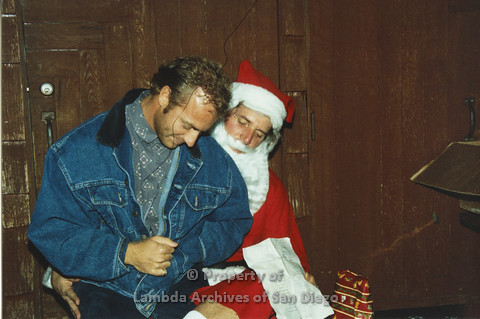P001.272m.r.t X-mas: man in jean jacket sitting on Santa's lap