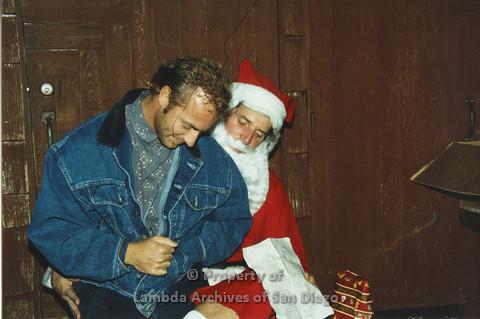 P001.272m.r.t X-mas: man in jean jacket sitting on Santa's lap