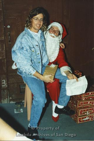P001.274m.r.t X-mas: man in jean jacket sitting on Santa's lap