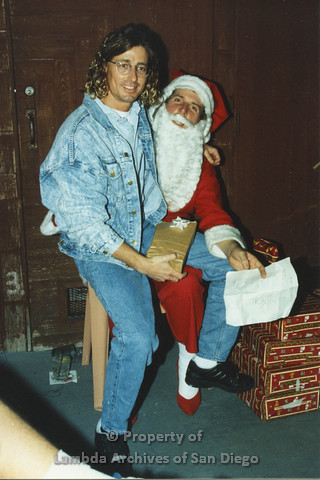 P001.274m.r.t X-mas: man in jean jacket sitting on Santa's lap