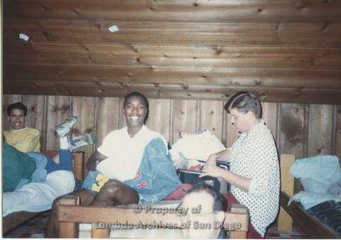P001.183m.r.t Retreat 1991: men on and around bunk beds