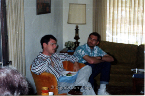 P103.151m.r.t Close up of two men seated in living room speaking