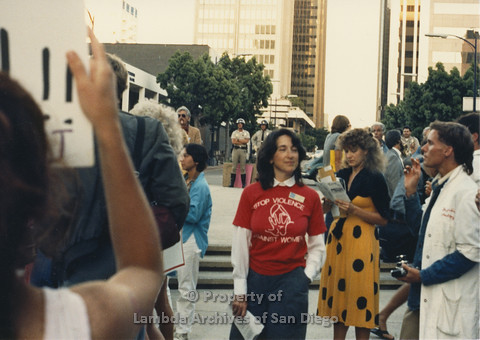 P024.119m.r.t Myth California Protest, San Diego, June 1986: Woman in a red t-shirt (Stop Violence Against Women)