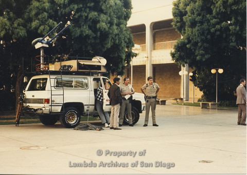 P024.135m.r.t Myth California Protest, San Diego, June 1986: news vehicle with polices officers standing in front