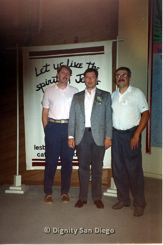 P103.147m.r.t Three men smiling for camera in front of Dignity San Diego banner. Left to right: Steve(?), unidentified man, Neil Manfredi