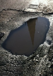 Puddle exposes view of the underworld