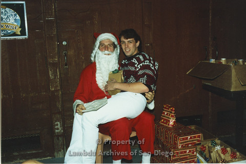P001.275m.r.t X-mas: man in red patterend sweater sitting on Santa's lap