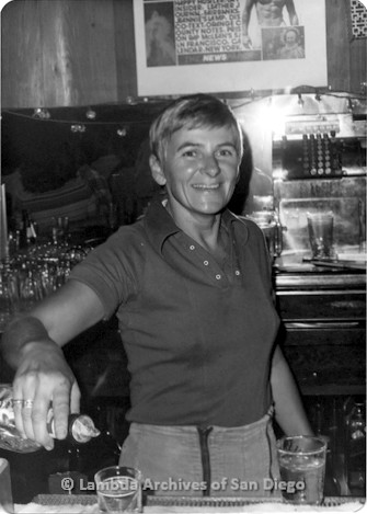 Diablo's Lesbian Bar in San Diego, located on El Cajon Blvd. in North Park. Assistant manager, Char smiles while pouring a drink.
