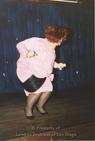 P001.260m.r.t Through The Years Fundraiser: drag queen wearing a pink dress and red wig
