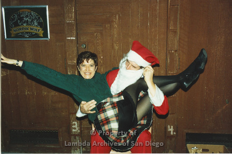 P001.269m.r.t X-mas: woman sitting in Santa's lap
