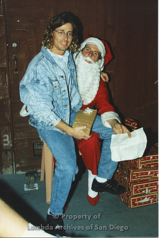 P001.262m.r.t Through The Years Fundraiser: man in jean jacket sitting on Santa Claus' lap