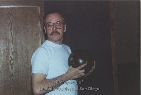 P001.143m.r.t Bowling 1991: man holding a bowling ball