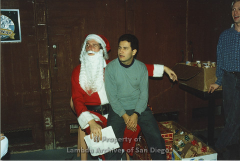 P001.288m.r.t X-mas: man in green sweater sitting on Santa's lap