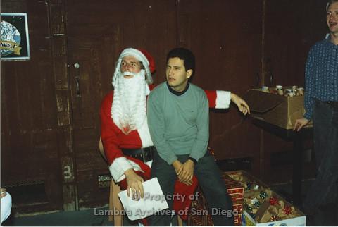P001.288m.r.t X-mas: man in green sweater sitting on Santa's lap