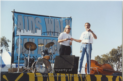 P001.120m.r.t AIDS Walk 1991: 2 men standing on stage