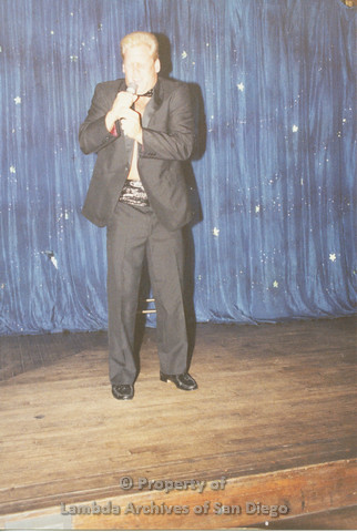 P001.251m.r.t Through The Years Fundraiser: man in tuxedo holding a microphone