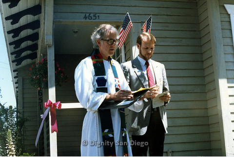 P103.170m.r.t San Diego Dignity Center: Priest and Bruce Neveu (left) standing in front of ribbon in front of Center