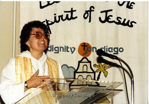 P103.028m.r.t Dignity San Diego: Female church leader speaking at church podium
