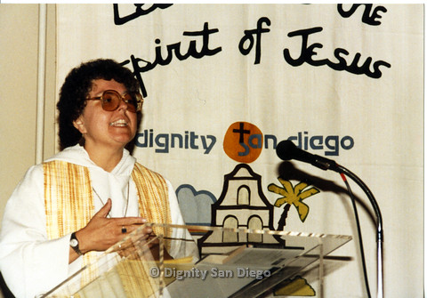P103.028m.r.t Dignity San Diego: Female church leader speaking at church podium