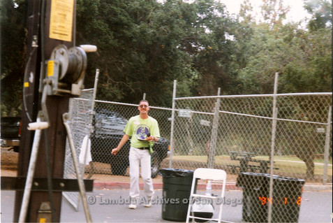 "P018.147m.r.t San Diego Pride Festival 1998: ""Gary"" walking out of fenced area"