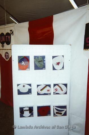 P096.006m.r.t LASD Pride Display: Display of pride hats with '77 Pride flag in background