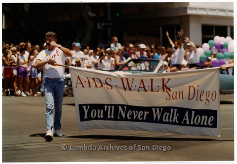 P201.009m.r.t San Diego Pride Parade 1992: Marchers carrying a banner for AIDS Walk San Diego