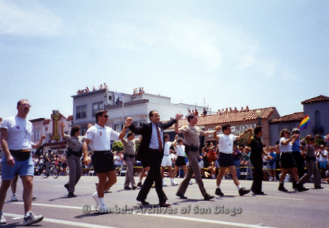 San Diego Pride Parade 1998: San Diego Peace Officers, Fire Department, Government Officials; Judge David Rubin (Center wearing suit), John Graham (Center in uniform)